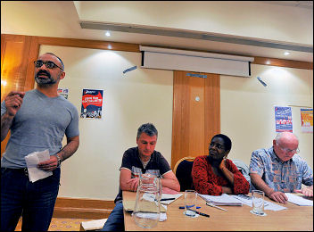 Onay Kasab, another of the four charged, is Branch Secretary Greenwich Unison. Here he addresses the Socialist Party fringe meeting at Unison conference 2009, photo Paul Mattsson
