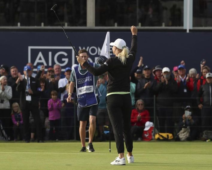 Sweden's AnnaNordqvist celebrates on the 18th green as she wins the Women's British Open golf championship, in Carnoustie, Scotland, Sunday, Aug. 22, 2021.