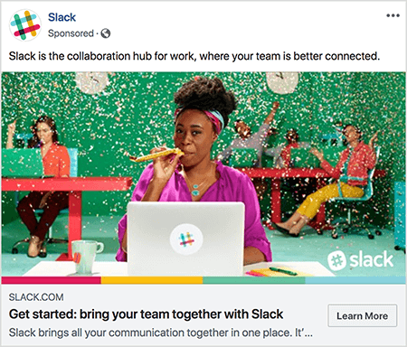 """This is a screenshot of a Facebook ad for Slack. The ad text says """"Slack is the collaboration hub for work, where your team is better connected."""" In the ad image, a black woman sits at a desk with a gray laptop. Her hair is short and held back with a colorful headband. She's wearing a fuschia blouse and turquoise necklace, and she's blowing through a yellow noisemaker. In the background, other people are sitting at desks and wearing colorful clothing. The office is painted bright green, and confetti is falling from the ceiling. Talia Wolf recommends using photos like this, which show raw emotion, in your ads."""