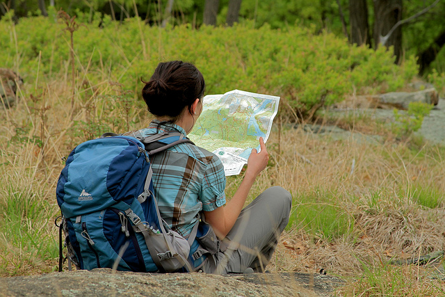 Hiker Looking at a Map