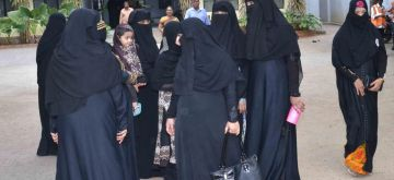 Hyderabad: Muslim women leaves after casting their vote at a polling station for the by-election to the Warangal Lok Sabha constituency in Telangana on Nov 21, 2015. (Photo: IANS)