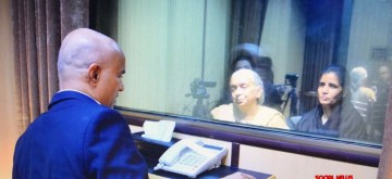 Islamabad: The mother and wife of Mumbai-based former naval officer-turned-businessman Kulbhushan Jadhav, who was arrested on March 3, 2016, and was sentenced to death by a Pakistani military court on charges of espionage and terrorism meet him at the Pakistan Foreign Office in Islamabad on Dec 25, 2017. The meeting, with the death row prisoner lasted for about 40 minutes, but with a glass panel separating them and spoke through a speaker phone. The meeting started at 2.18 p.m., according to the Foreign Office. Indian Deputy High Commissioner J.P. Singh, who accompanied Jadhav's family, was seen watching the reunion from a distance. (Photo: Twitter/@ForeignOfficePk)