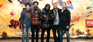 """LONDON, ENGLAND - OCTOBER 28: Film Directors Bob Persichetti (2ndL), Peter Ramsey (2ndR) and Rodney Rothman (R), and international voice cast Shameik Moore (C) (English language voice of Miles Morales) and Peng Yuchang (L)(Chinese voice of Miles Morales) attend a stylish graffiti photo call to celebrate the ground-breaking new animation movie """"Spider-Man: Into The Spider-Verse"""" on October 28, 2018 in London, England. The film hits global cinemas from December 12th.  (Photo by Mike Marsland/Mike Marsland/Getty Images for Sony Pictures Releasing International)"""