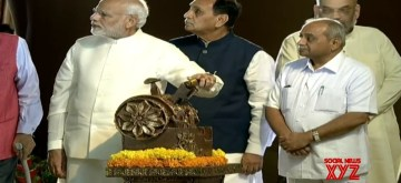 Kevadia (Gujarat): Prime Minister Narendra Modi along with Gujarat Chief Minister Vijay Rupani and Deputy Chief Minister Nitin Patel unveils 182-metre high 'Statue of Unity' in honour of country's first Home Minister Sardar Vallabhbhai Patel in Kevadia, Gujarat on Oct 31, 2018. Also seen BJP chief Amiyt Shah. (Photo: IANS/BJP)