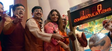 Mumbai: Actress Neetu Chandra ringing the bell during the one-hour long Muhurat trading on Diwali at BSE in Mumbai on Nov 7, 2018. Also seen BSE MD and CEO Ashish Chauhan. (Photo: IANS)