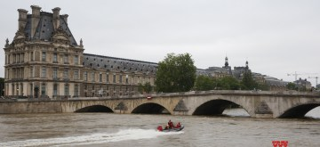 PARIS, June 3, 2016 (Xinhua) -- A police boat patrols on the Seine river in front of Louvre museum in Paris, France, June 3, 2016. Due to heavy rainfall across French cities, flood waters have reached alarming level, forcing thousands of people to quit their homes, and plunged Paris' vibrant venues and most visited sites into chaos. (Xinhua/Ye Pingfan/IANS)
