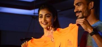Mumbai: Actress Pooja Hegde and Asian Marathon Champion Gopi. T unveil the official 'Race Day Tee' for the 16th edition of the Tata Mumbai Marathon in Mumbai on Dec 20, 2018. (Photo: IANS)