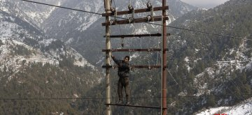 Naddi: A lineman repairs the power line that had collapsed due to heavy snowfall in Himachal Pradesh's Naddi village on Jan 7, 2019. (Photo: IANS)