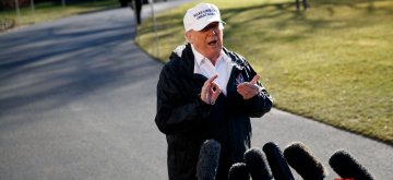 """WASHINGTON, Jan. 10, 2019 (Xinhua) -- U.S. President Donald Trump speaks to reporters before leaving the White House in Washington D.C., the United States, on Jan. 10, 2019. Donald Trump said Thursday he """"would almost say definitely"""" that he would declare a national emergency at the U.S.-Mexico border, a controversial option he has been publicly contemplating since last week. (Xinhua/Ting Shen/IANS)"""