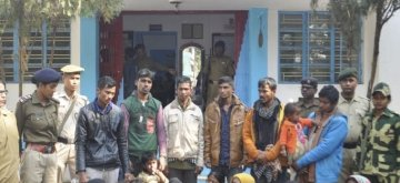 Agartala: 31 Rohingya Muslims who were trying to enter Bangladesh from India and were detained by the Border Security Force (BSF) along the India-Bangladesh International Border, being handed over to Amtali Police in Agartala, on Jan 22, 2019. (Photo: IANS)