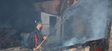 Guwahati: A fire fighter douses fire that broke out at Hatigaon in Guwahati, on Feb 1, 2019. (Photo: IANS)