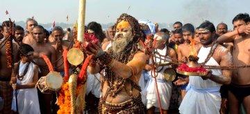 Allahabad: An ascetic performs rituals on Mauni Amavasya at Sangam -- the confluence of the three holy rivers Ganga, Yamuna and the mythical Saraswati in Allahabad on Jan 16, 2018. (Photo: IANS)