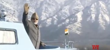 Prime Minister Narendra Modi waves at public while taking a boat ride in Srinagar's Dal Lake on Jan 3, 2019.