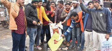 Mathura: Right wing activists burn greetings cards on Valentine's Day in Mathura on Feb 14, 2019. (Photo: IANS)