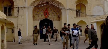 Jaipur: Rajasthan Director General (prisons) NRK Reddy, accompanied by senior officers coming out from the entrance gate of Jaipur central jail where a Pakistani prisoner allegedly murdered by group of fellow prisoners after an argument over a TV programme with other prisoners turned violent; in Jaipur on Feb 20, 2019. The prisoner identified as Shakarullah, alias Mohammad Haneef, 45, who was undergoing imprisonment after being convicted for spying. (Photo: Ravi Shankar Vyas/IANS)