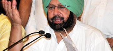 Amritsar MP and Congress leader Captain Amarinder Singh addresses a press conference in Amritsar on June 26, 2014. (Photo: IANS)