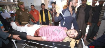 Jammu: One of the 30 persons inured in Jammu bus stand grenade attack being wheeled into a Jammu hospital for treatment on March 7, 2019. One person was killed when a grenade was rolled under a packed parked bus in Jammu's main bus stand by a militant. (Photo: IANS)