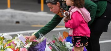 CHRISTCHURCH, March 16, 2019 (Xinhua) -- A woman places a card to mourn the victims of the attacks on two mosques in Christchurch, New Zealand, on March 16, 2019. It was revealed that a 28-year-old Australian man, Brenton Tarrant, conducted terrorist attacks targeting mosques in Christchurch and later was arrested by New Zealand Police. At least 49 people were killed and 48 are hospitalized now. (Xinhua/Guo Lei/IANS)