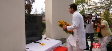 Imphal: Congress President Rahul Gandhi pays tribute at Shaheed Minar in Imphal on March 19, 2019. (Photo: IANS)