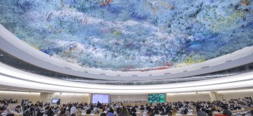 """GENEVA, Feb. 28, 2019 (Xinhua) -- The 40th session of the UN Human Rights Council (UNHRC) is held in Geneva, Switzerland, Feb. 27, 2019. The 56 ethnic groups in China, living together like brothers and sisters, are all part of the big family of the Chinese nation, Yu Jianhua, head of the Chinese Mission to the UN Office in Geneva,  said on Wednesday at the ongoing UNHRC session. """"The people of all ethnic groups are tightly held together like pomegranate seeds, and together they are making arduous efforts for the great rejuvenation of the Chinese nation where they can all live a happy life,"""" Yu said, when elaborating on China's human rights propositions and expounding achievements of the human rights undertakings in Xinjiang Uygur Autonomous Region in northwest China. (Xinhua/Xu Jinquan/IANS)"""