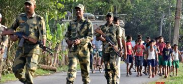 North 24 Parganas: Border Security Force (BSF) personnel conduct flag march ahead of 2019 Lok Sabha elections in West Bengal's North 24 Parganas on March 27, 2019. (Photo: IANS)