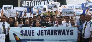 New Delhi: Jet Airways employees stage a demonstration against delay in disbursement of their salaries at Delhi Airport's Terminal 3 (T3) on April 13, 2019. (Photo: IANS)