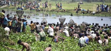 Nagaon: Villagers use traditional Assamese fishing net 'Jakoi' to catch fish as they participate in community fishing during Rongali Bihu celebrations, at Digholi lake in Nagaon district of Assam, on April 13, 2019. (Photo: IANS)