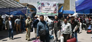 Darjeeling: Polling officials carry Electronic Voting Machine (EVMs) and other necessary inputs after collecting them from the distribution centre on the eve of the second phase of 2019 Lok Sabha elections in Darjeeling, West Bengal on April 17, 2019. (Photo: IANS/PIB)