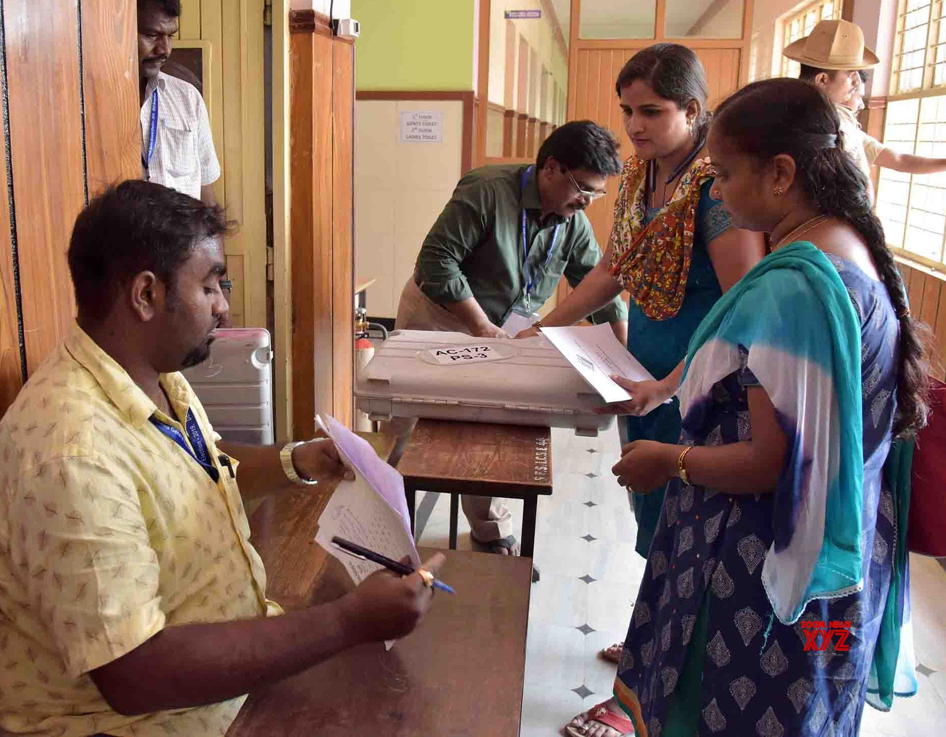 Bengaluru: 2019 Lok Sabha elections - Polling officials collect EVMs and other necessary inputs #Gallery