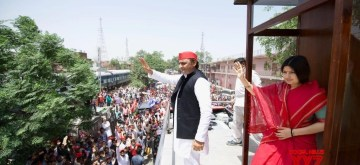 Samajwadi Party President Akhilesh Yadav and her wife and the party's Lok Sabha candidate from Kannauj Dimple Yadav wave at supporters during a roadshow ahead of the 2019 Lok Sabha elections in Uttar Pradesh's Kannauj on April 27, 2019. Kannauj is one of the thirteen constituencies in Uttar Pradesh that will go to polls in the fourth phase of 2019 Lok Sabha elections on April 29, 2019. (Photo: Twitter/@yadavakhilesh)