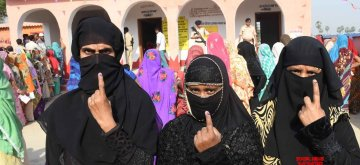 Vaishali: Burqa clad women show their forefingers marked with indelible ink after casting vote during the sixth phase of 2019 Lok Sabha elections, in Vaishali, Bihar on May 12, 2019. (Photo: IANS)
