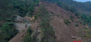 Mangla: Bulldozers trapped in debris after a landslide occurred at Chamba-Khajjiar road near Mangla village of Himachal Pradesh's Chamba district, on May 15, 2019. (Photo: IANS)