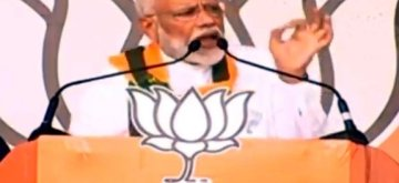 Deoghar: Prime Minister Narendra Modi addresses a public rally in Deoghar, Jharkhand on May 15, 2019. (Photo: IANS)
