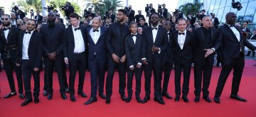 "CANNES, May 16, 2019 (Xinhua) -- Director Ladj LY (5th R) and other cast members pose on the red carpet for the premiere of the film ""Les Miserables"" at the 72nd Cannes Film Festival in Cannes, France, on May 15, 2019. The 72nd Cannes Film Festival is held here from May 14 to 25. (Xinhua/Zhang Cheng/IANS)"