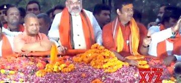 Gorakhpur: BJP chief Amit Shah, party's Gorakhpur Lok Sabha candidate Ravi Kishan and Uttar Pradesh Chief Minister Yogi Adityanath during a roadshow in Gorakhpur, Uttar Pradesh on May 16, 2019. (Photo: IANS)