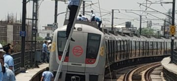 Gurugram: Technicians from the maintenance teams of Delhi Metro Rail Corporation (DMRC) rectify technical glitches that led to delay in services in Delhi Metro's Yellow Line, that runs between Huda City Centre in Gurugram to Samaypur Badli, on May 21, 2019. The snag occurred at the Chattarpur station at 9.30 a.m. Services resumed after 11.30 a.m. (Photo: IANS/DMRC)