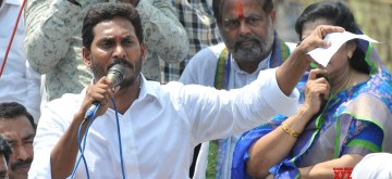 Palasa : YSR Congress Party chief Y.S. Jaganmohan Reddy addresses party workers and supporters during a public meeting in Palasa of Andhra Pradesh's Srikakulam district on March 23, 2019. (Photo: IANS)