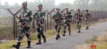 Hili: Border Security Force (BSF) soldiers on patrol duty along the India-Bangladesh Border fence at Hili near Balurghat in South Dinajpur district of West Bengal on Jan 24, 2016. (Photo: IANS)