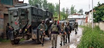 Pulwama: Security forces conduct cordon and search operations after two militants were killed in a gunfight with the security forces in Jammu and Kashmir's Pulwama district, on May 18, 2019. One of the slain militants has been identified as Showkat Ahmad Dar, a resident of Panzgam village. He belonged to the Hizbul Mujahideen (HM) outfit. (Photo: IANS)