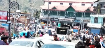 Mussoorie: Mussoorie's Mall Road witnesses traffic jam as a large number of tourists are arriving in the city; on June 10, 2019. The summer rush in the Uttarakhand hills this season getting heavier. As the mercury rises in the plains, tens of thousands of tourists are flocking to the hills on a daily basis cramming roads and highways with serpentine snarls being a constant feature at top tourist destinations like the Char Dham shrines, Mussoorie, Nainital and Corbett Tiger Reserve. (Photo: IANS)