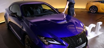 Seoul: A model stands beside the new Lexus RC F coupe, manufactured by Toyota Motors Corp., during a publicity event in Seoul on June 12, 2019.(Yonhap/IANS)