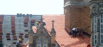 Mumbai: Repair works underway at the rooftop of Chhatrapati Shivaji Maharaj Terminus during the onset of monsoon, in Mumbai on June 13, 2019. (Photo: IANS)