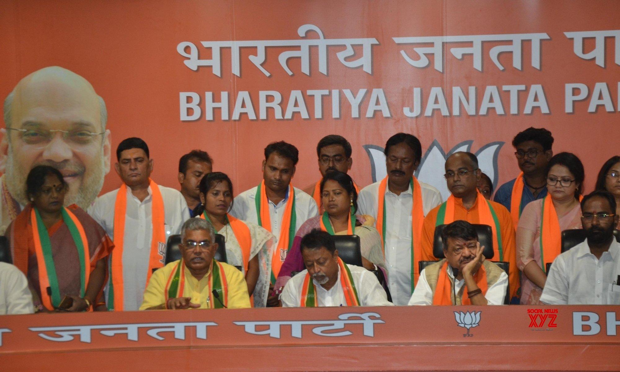 TMC MLA, 12 councillors join BJP