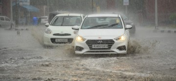 Jaipur: Vehicles struggle through a water logged street during rains, in Jaipur, on June 18, 2019. (Photo: Ravi Shankar Prasad/IANS)