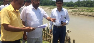 Nalbari: Assam Water Resources Minister Keshab Mahanta takes stock of the situation in the flood-affected Nalbari district of Assam, on July 1, 2019. (Photo: IANS)