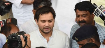 Patna: RJD leader Tejashwi Yadav arrives at Bihar Assembly after failing to attend the ongoing Monsoon Session for four consecutive days, in Patna on July 4, 2019. (Photo: IANS)