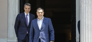 ATHENS, July 8, 2019 (Xinhua) -- Former Greek prime minister Alexis Tsipras (R) leaves the Maximos Mansion as the newly elected prime minister Kyriakos Mitsotakis looks on at the Maximos Mansion in Athens, Greece, July 8, 2019. Kyriakos Mitsotakis, leader of Greece's conservative New Democracy party, was sworn in on Monday as Greece's new prime minister after winning Sunday's national snap elections. TO GO WITH Conservative leader Kyriakos Mitsotakis sworn in as Greece's new PM. (Xinhua/Lefteris Partsalis/IANS)