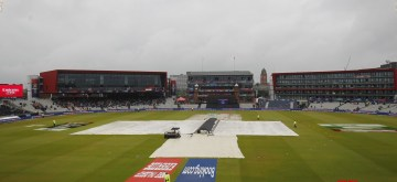 Manchester: A view of the pitch at Old Trafford covered with plastic sheets during rains that interrupted the 1st Semi-final match of 2019 World Cup between India and New Zealand in Manchester, England on July 9, 2019. (Photo: Surjeet Kumar/IANS)