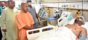 Lucknow: Uttar Pradesh Chief Minister Yogi Adityanath visits the victims of Yamuna Expressway bus accident receiving treatment at the Sanjay Gandhi Postgraduate Institute of Medical Sciences (SGPGIMS) in Lucknow on July 10, 2019. (Photo: IANS)