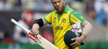 Birmingham: Australia's David Warner walks back to the pavilion after getting dismissed during the second semi-final match of the 2019 World Cup between Australia and England at the Edgbaston Cricket Stadium in Birmingham, England on July 11, 2019. (Photo: Surjeet Kumar/IANS)
